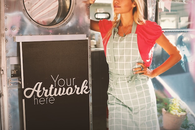Waitress standing in food truck with a blackboard mockup