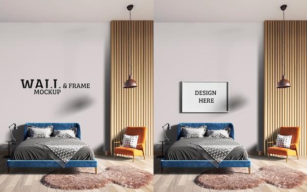 壁とフレームのモックアップ青いベッドとオレンジ色の椅子を備えたスタイリッシュなベッドルーム