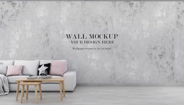 白いソファの後ろの壁の背景のモックアップ