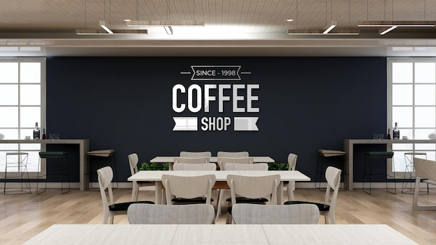 テーブルとデスクのあるコーヒーショップの壁のロゴのモックアップ