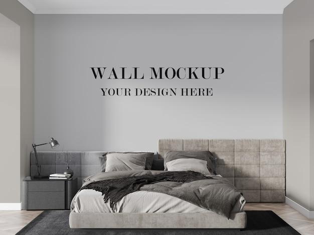 大きなモダンなベッドの背後にある壁のモックアップ3dレンダリング