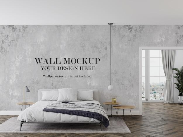 モダンな白いベッドの後ろの壁のモックアップ