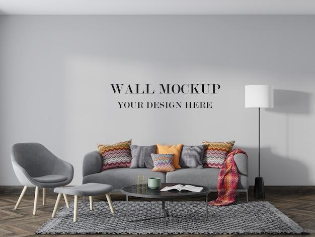 Wall mockup behind colorful pillows and soft furnishings