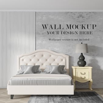 Wall mockup behind elegant bed with minimalist furniture