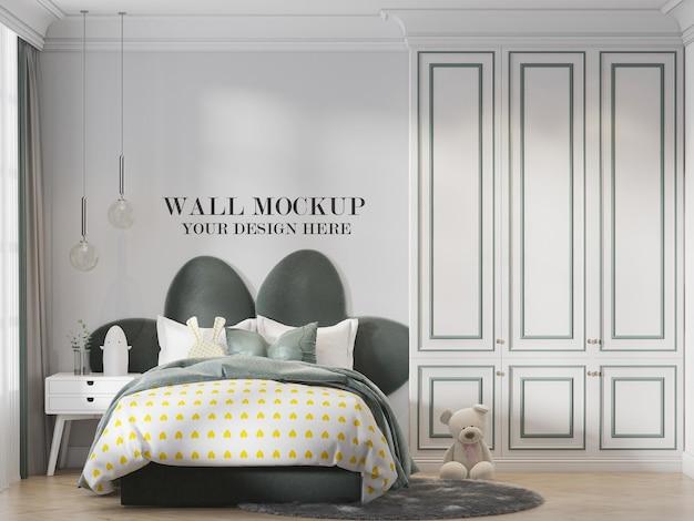 Wall mockup behind green headboard bed