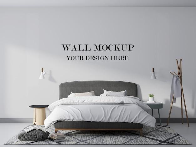 ランプ付きの快適なベッドルームの壁のモックアップ