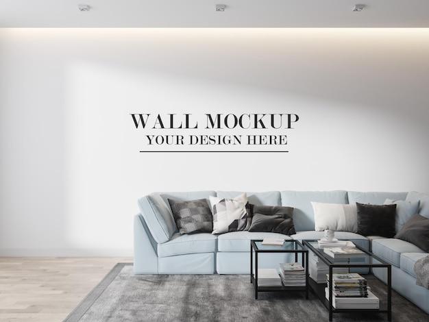 Wall mockup behind light blue sofa in 3d rendering