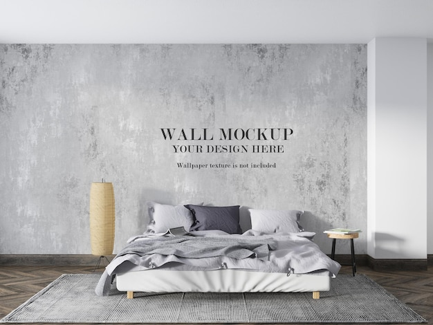 Wall mockup behind low bed with minimalist furniture