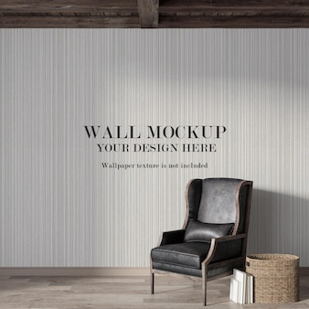 Wall mockup behind old leather chair with minimalist furniture
