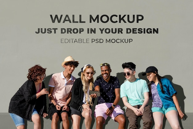 Wall mockup psd, teen friends watching a video on a smartphone