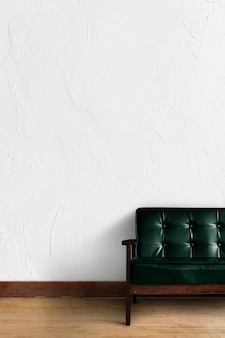 Wall mockup psd with sofa in living room