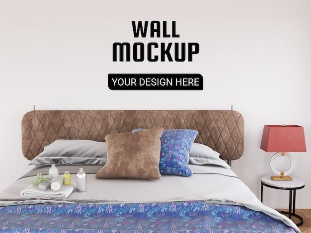 モダンなベッドルームでリアルな壁のモックアップ