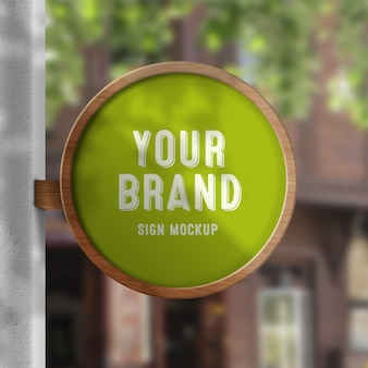 Wall sign logo mockup with blurred background