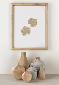 Wall with vases and frame with leaves