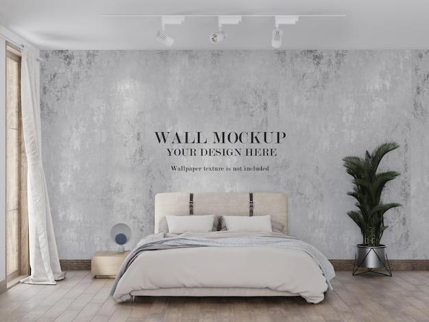 モダンなベッドデザインの背後にある壁紙のモックアップ