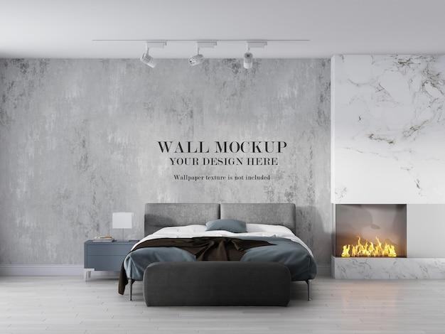 モダンなベッドルームの暖炉の横にある壁紙のモックアップ