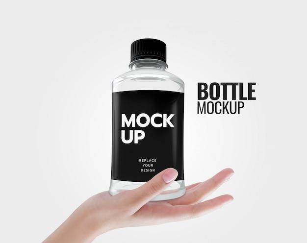 水のモックアップにボトルを飲む