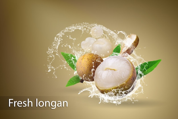 Water splashing on fresh longan over a dark background