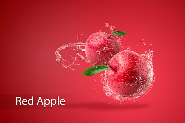 Water splashing on fresh red apple on red background.