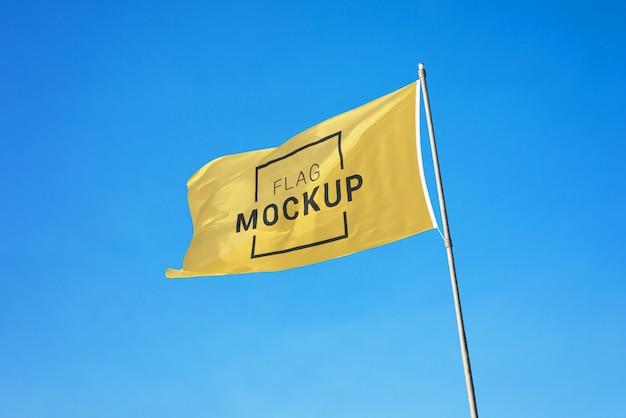 Waving flag template. blank flag on flagpole mockup