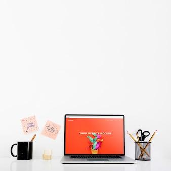 Website mockup with laptop on desk