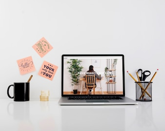 Website mockup with laptop on desk