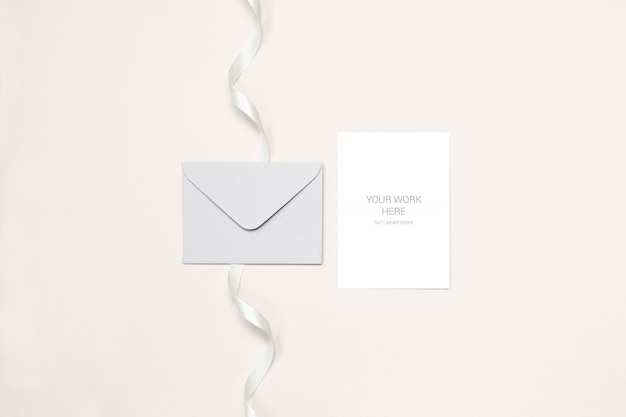 Wedding card mockup with envelope and ribbon