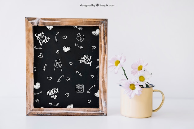 Wedding decoration with slate and flowers in mug