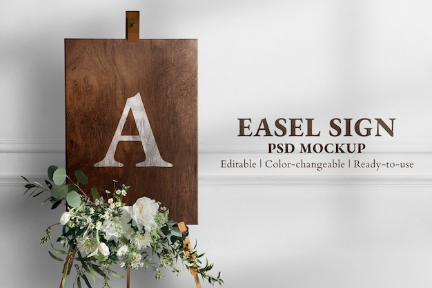 Wedding easel sign mockup psd in wooden texture with flowers