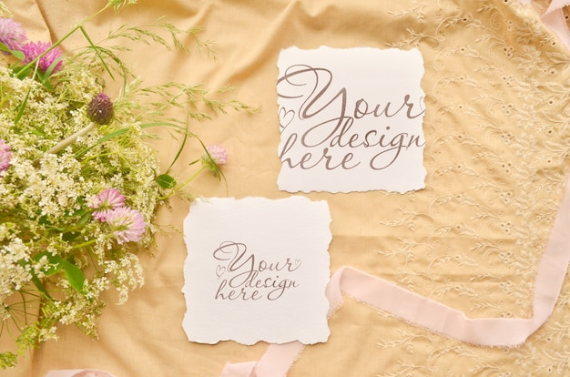 Wedding flat lay with paper cards and wild flowers