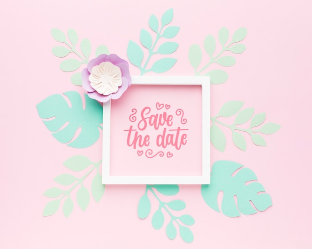 Wedding frame mock-up with paper leaves on pink background