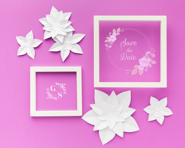 Wedding frame with paper flowers on purple wallpaper