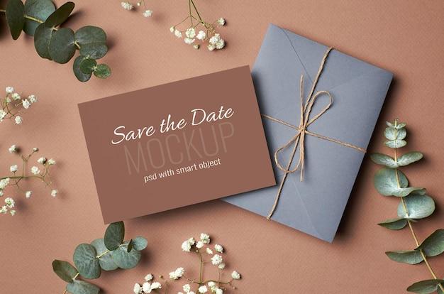 Wedding invitation card mockup with envelope, eucalyptus and hypsophila twigs