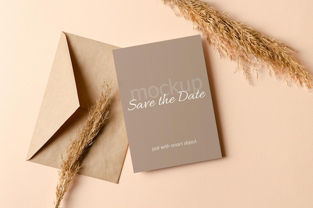 Wedding invitation or greeting card mockup with envelope and dry plant decorations