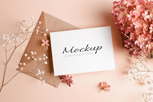 Wedding invitation or greeting card mockup with pink hydrangea flowers
