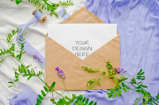 Wedding invitation mockup with flowers and silk ribbons