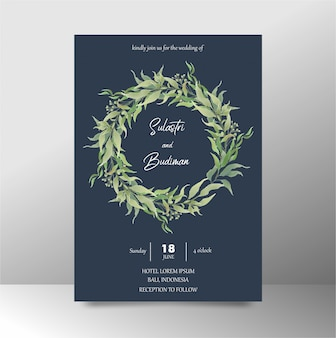 Wedding invitation template with navy blue watercolor leaves