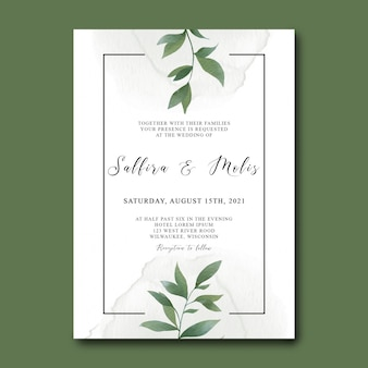 Wedding invitation template with watercolor green leaves
