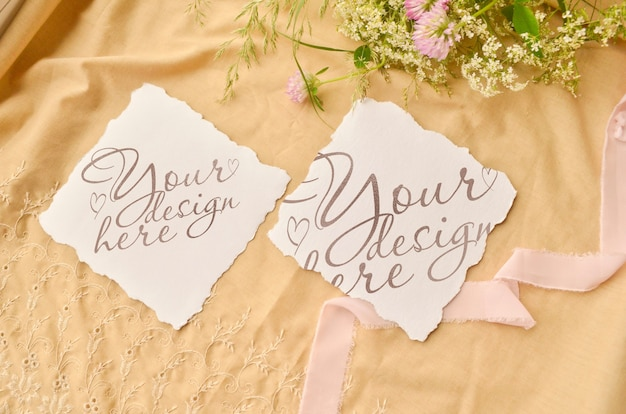 Wedding invite card mockup. flowers and ribbon around