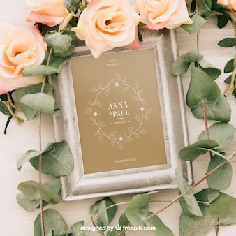 Wedding mock up with frame, flowers and leaves