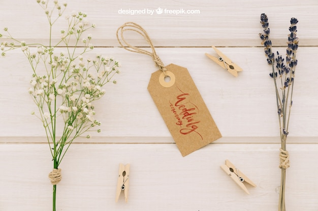Wedding mock up with label, flowers and clothespins