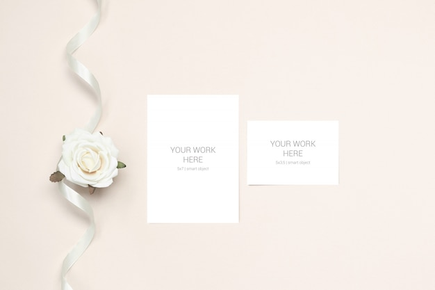 Wedding mockup greeting card and rsvp with flower and ribbon