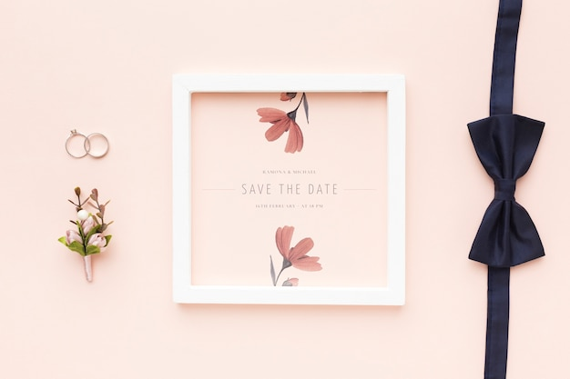 Wedding rings and bow tie with frame mock-up and flower