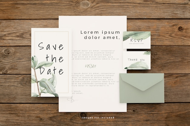 Wedding stationery set with beautiful leaves on brown wooden table