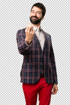 Well dressed man doing coming gesture