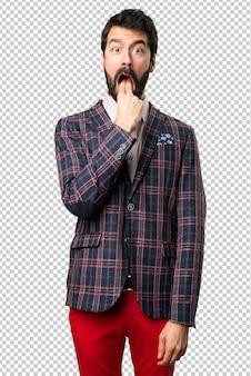 Well dressed man making vomiting gesture