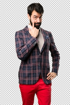 Well dressed man showing something
