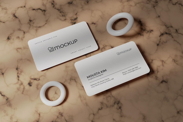 White business card on marble background mockup
