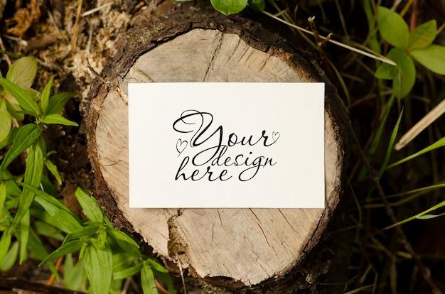 White business card mockup on wood