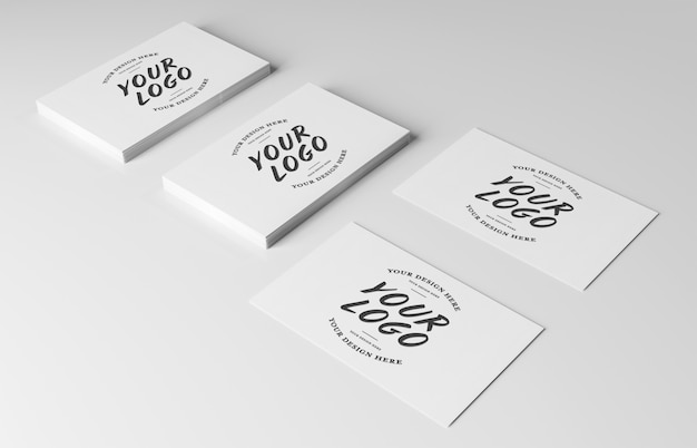 White business card pile on white surface mockup